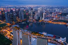 Aerial view of Downtown Singapore city in Marina Bay area. Financial district and skyscraper buildings at night.  royalty free stock photos