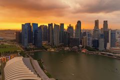 Aerial view of Downtown Singapore city in Marina Bay area. Financial district and skyscraper buildings at sunset.  stock photos