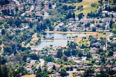 Aerial view of Dr. Robert Gross Groundwater Recharge Pond surrounded by a residential neighborhood, San Jose, South San Francisco. Bay area stock images