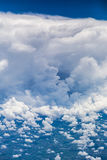 Aerial view of dramatic cloud formation and cityscape below royalty free stock image