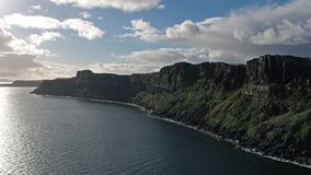 Aerial view of the dramatic coastline at the cliffs by Staffin close to the famous Kilt Rock waterfall - Isle of Skye -. Scotland stock video footage