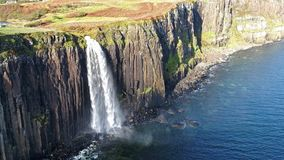 Aerial view of the dramatic coastline at the cliffs by Staffin with the famous Kilt Rock waterfall - Isle of Skye -. Scotland stock video footage