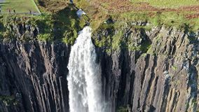 Aerial view of the dramatic coastline at the cliffs by Staffin with the famous Kilt Rock waterfall - Isle of Skye -. Scotland stock footage