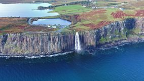 Aerial view of the dramatic coastline at the cliffs by Staffin with the famous Kilt Rock waterfall - Isle of Skye -. Scotland stock video