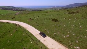 Aerial View Of Driving Car On Hilly Terrain stock footage