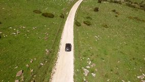 Aerial View Of Driving Car On Hilly Terrain stock video footage