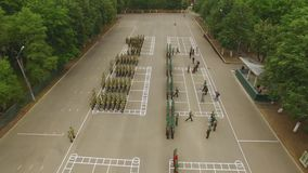 Aerial view. Drone, air shoot. Rewards soldiers. Military parade. Officers salute the general or commander, receive