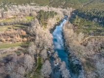 Aerial view of drone, artificial lake and dense forest on the banks. In Portugal river water blue nature natural trees vegetation green pine oaks colors flora royalty free stock photos