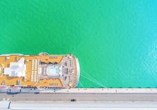 Aerial View by Drone of Cruise ship at harbour. Top view of beautiful large white liner in yacht club. Luxury cruise in sea water. Marina dock. Ship is moored royalty free stock images