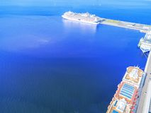 Aerial View by Drone of Cruise ship at harbour. Top view of beautiful large white liner in yacht club. Luxury cruise in sea water. Marina dock. Ship is moored royalty free stock photo