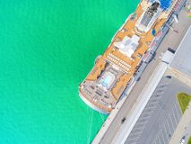 Aerial View by Drone of Cruise ship at harbour. Top view of beautiful large white liner in yacht club. Luxury cruise in sea water. Marina dock. Ship is moored stock image