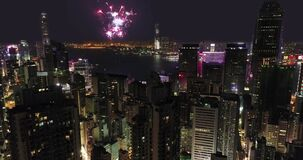 AERIAL. View from the drone. Firework Show at HongKong City Night time