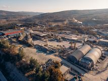 Aerial view from drone of industrial area with warehouses, buildings, trucks, industry equipment, heavy transport royalty free stock image