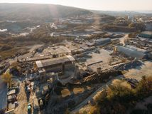Aerial view from drone of industrial area with warehouses, buildings, trucks, industry equipment, heavy transport royalty free stock photo