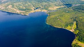 Aerial view from the drone of landscape Volga river flows among the hills and fields. The middle band of Russia stock photos