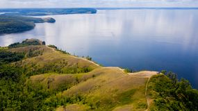 Aerial view from the drone of landscape Volga river flows among the hills and fields. The middle band of Russia royalty free stock image