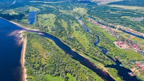Aerial view from the drone of landscape Volga river flows among the hills and fields. The middle band of Russia stock image