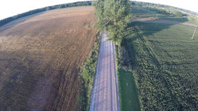 Aerial view from drone over beautiful farmland gravel road stock video footage