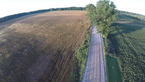 Aerial view from drone over gravel road in summer end stock footage