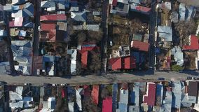 Drone view over roofs. Aerial view from drone over roofs, small village stock footage
