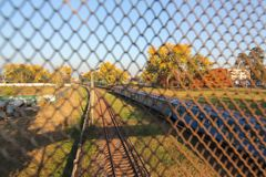 Aerial view from drone on railway road between trees. Landscape background with steel rails. The net is a rabie through which the