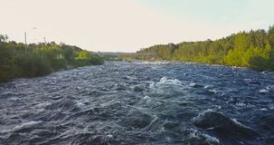 Aerial View from Drone of Rough River. Aerial View from Drone of Rough Niva River flowing through the Kandalaksha Town in Russia Stock Images