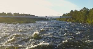 Aerial View from Drone of Rough River. Aerial View from Drone of Rough Niva River flowing through the Kandalaksha Town in Russia Royalty Free Stock Image