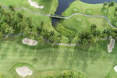 Aerial view drone shot of beautiful green golf field. stock photos
