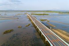 Aerial view Drone shot of BridgeEkachai bridgeColorful Road bridge cross the lake at Talay Noi Lake in Phatthalung province. Thailand stock photography