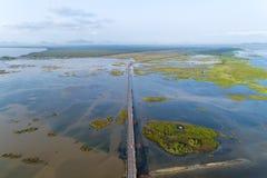 Aerial view Drone shot of BridgeEkachai bridgeColorful Road bridge cross the lake at Talay Noi Lake in Phatthalung province. Thailand stock images