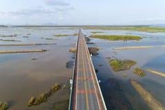 Aerial view Drone shot of BridgeEkachai bridgeColorful Road bridge cross the lake at Talay Noi Lake in Phatthalung province. Thailand royalty free stock images