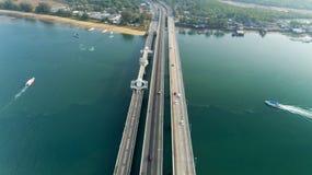 Aerial View Drone shot of sarasin bridge Phuket thailand image transportation background and travel season concept.  stock photo