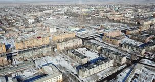 Aerial view of the drone on a small town. Winter season. Low five-storey houses. stock video footage