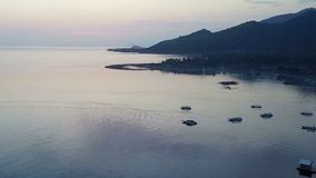 Aerial view from drone,Stony seacoast and mountains on a sunset. Indonesia. Bali. stock video