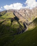 Aerial view from drone to mountains with ravine and fracture near mountain Kazbegi in Georgia. Stepantsminda village, travel, landscape, nature, caucasus, hill stock image
