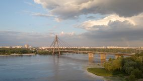 Pivnichnyi Bridge across the Dnieper in Kiev. Panoramic view fro the drone. Aerial view from the drone to Pivnichnyi Bridge across the Dnieper in Kiev at sunset stock image