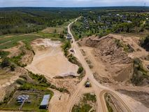 Aerial view from drone to sand pit, sunny day. Russia Stock Image