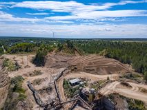 Aerial view from drone to sand pit, sunny day. Russia Stock Photos