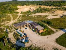 Aerial view from drone to sand pit, sunny day Stock Photos