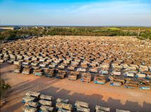 Aerial view from drone trucks loaded with sugar cane in a truck parking outside sugar cane factory.  stock images
