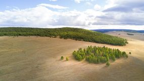 Aerial view of a vast landscape in Mongolia. Aerial view from a drone of a vast mountain landscape in northern Mongolia. Khuvsgol, Mongolia Stock Photos