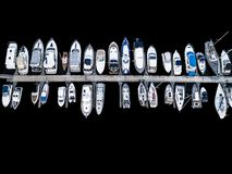 Aerial View by Drone of Yacht Club and Marina. Top view of yacht club. White boats in sea water. Marina dock yachts and small moto. R boats. Yacht and sailboat royalty free stock photos