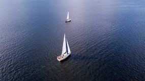 Aerial view from the drone of the yachts with white sails at sea stock image