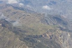 Aerial view of dry desert and the Andes Mountains somewhere over. South America stock images