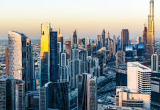 Aerial view of Dubai business bay towers at sunset. Stock Photos