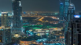 Aerial view of Dubai downtown Lake area night timelapse and skyscrapers of Old Town Island, from top. Skyline urban city stock video