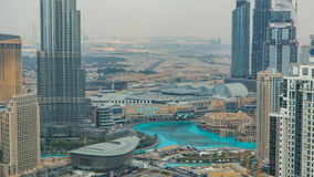 Aerial view of Dubai downtown Lake area timelapse and skyscrapers of Old Town Island, from top. Skyline urban city of stock footage
