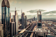 Aerial view of Dubai famous architecture with highway and skyscrapers. Stock Photography