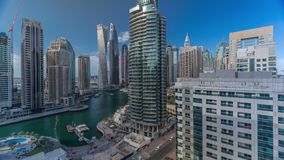Aerial view of Dubai Marina residential and office skyscrapers with waterfront timelapse. Aerial paniramic view of Dubai Marina residential and office stock footage