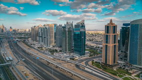Aerial view of Dubai marina skyscrapers and Jumeirah lakes towers timelapse with traffic on sheikh zayed road.